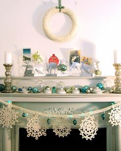 Vintage Christmas. I'm not so big on the reindeer thingies, but I love the mercury glass candleholders (want some, BAD!), and the blue and green ball ornaments, and the snowflake garland.