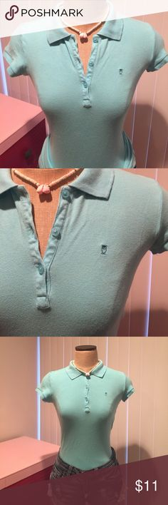 Stretchy teal polo with button down collar Stretchy polo shirt with button down collar. Excellent condition. 97% cotton 3% spandex mossimo Tops