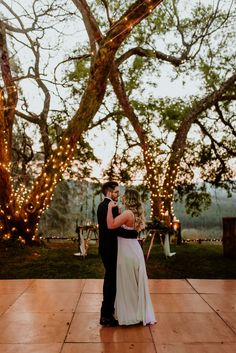 Grace and Luan dancing under the beautiful old trees in front of Mina's Old Trees, Real Weddings, Dancing, White Dress, Wedding Ideas, Beautiful, Dance, White Dress Outfit, Wedding Ceremony Ideas
