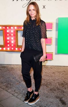 Stella McCartney wears a polka-dot blouse paired with relaxed trousers and platform oxfords