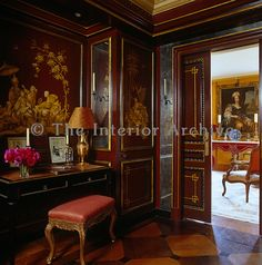 A red-lacquered sliding door opens from the Chinese boudoir into the drawing room