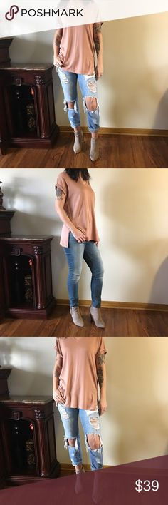 """✨Rosey Nude Side Slit Tee✨ One of the softest tees I have ever felt, in an awesome rosey nude color..v-neck with side slits..cuffed sleeve..definitely a staple piece to any girl's wardrobe! Price firm.  💕I'm 5'7"""" modeling the Small 💕Rayon, viscose, spandex blend  💕Bust measurements: S-19"""" M-20"""" L-21"""" 💕Length: 28.5 Boutique Tops Tees - Short Sleeve"""