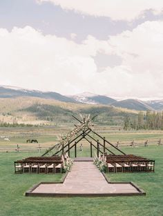 This outdoor wedding venue in the Rocky Mountains was a perfect rustic and unique venue for this earthy couple. With the beautiful capped mountains and wildlife in the back, it made for a perfect wedding photoshoot. Click to see more wedding inspiration from this Earthy, Bohemian Décor with Modern Romance wedding. #Wedding #WeddingVenue #RusticWeddingVenue #OutdoorWedding #WeddingInspiration #Bohemian #Modern #Earthy #RockyMountains #DestinationWedding | Martha Stewart Weddings