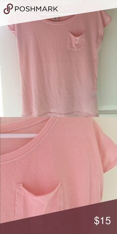 Abercrombie kids short sleeve top Abercrombie kids short sleeve top. Light pink pink and is 60% cotton and 40% polyester. Never worn, new with out tags. Let me know if you have any question or comments and make an offer! abercrombie kids Shirts & Tops Tees - Short Sleeve