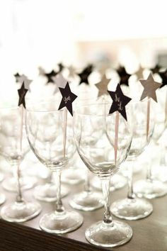 star place holders in wine glasses, great dinner party idea.