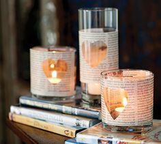 Estes copinhos foram customizados com jornal. O formato de coração deixa o objeto romântico, perfeito para decorar uma mesa a dois