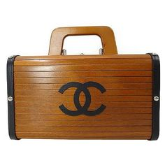 1990s Vintage CHANEL genuine wood handbag, mini trunk case with black cc mark. | From a collection of rare vintage top handle bags at https://www.1stdibs.com/fashion/handbags-purses-bags/top-handle-bags/