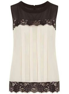 I love the black lace on the bottom of this blouse and that the torso has some distraction with pleats.