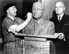 """Former President Truman poses for a bronze bust. Sculptor Rene Shapshak (left) works on a clay model for a bronze bust of former President Harry S. Truman. Truman is in his office in the Federal Reserve Bank Building, Kansas City, Missouri. The sculpture was placed in the Hall of Fame at the Ben Yehuda National Museum in Jerusalem, Israel. It was unveiled in Israel on Truman's 73rd birthday. The photo is autographed: """"To our Harry S. Truman, a great man, a great person - Rene Shapshak…"""