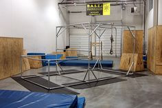 A freestanding, portable parkour structure that was built by Ayren at Base Fittness with Kee Klamp pipe fittings and pipe.