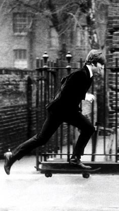 John Lennon skateboarding | skater | skating | vintage | movement | black & white photography | great shot | iconic | musician | icon | the Beatles