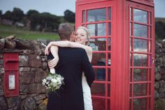 Bride and groom with red phone box and letter box, Knipe Hall