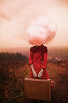 RED. Photographer Creates Whimsical Self-Portraits About What Traveling Means To Her.