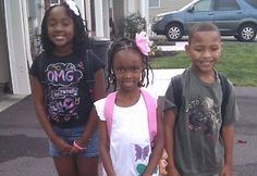 Asia, 4th grade; Laila, 1st grade; and Julius, 3rd grade, get ready to go to Andrew Buchanan.