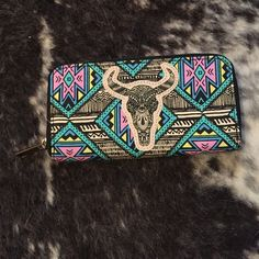 Target Patterned Cowskull wallet This is a cool boho-esque wallet with a cow skull appliqué. Never used. Target Bags Wallets