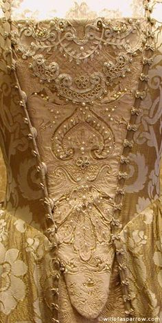 Embroidered stomacher. You can see where the stomacher snaps into the open robe. traditionally was attached with straight pins and a flap of ribbon to prevent snags