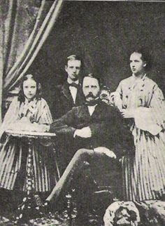 Dagmar (left) and Alexandra (right) with their brother, Prince Wilhelm (the future King George I of Greece), and their father, King Christian IX of Denmark.