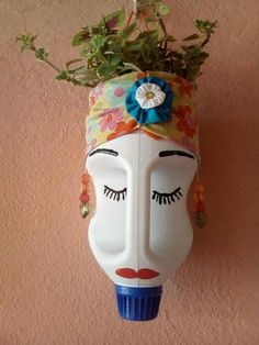DIY Face Shaped Painted Plastic Bottle Planters - Unique Balcony & Garden Decoration and Easy DIY Ideas Plastic Bottle Planter, Reuse Plastic Bottles, Plastic Bottle Flowers, Plastic Bottle Crafts, Face Planters, Diy Planters, Bleach Bottle, Plants In Bottles, Garden Crafts