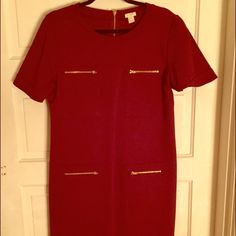 J crew dress Never worn but accidentally took the tags off and that's why I couldn't return it to the store! It's very cute stretchy maroon (wine) color dress from J Crew! The picture makes the dress look very wide but it's more slimming and form fitting. The material is thicker so dress is more for the fall winter than summer J. Crew Dresses