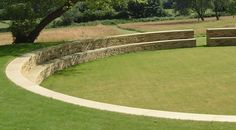 Old Rectory - landscape design project in Sussex by Christopher Bradley-Hole. Using dry stone walling a large amphitheatre was created, with stunning views across the meadows.
