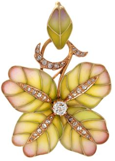 An Art Nouveau 18 karat gold pendant with diamonds and plique a jour enamel. The pendant features a plique a jour enamel flower with an old European-cut diamond center with an approximate weight of .15 carats. The flower is decorated with 34 rose-cut diamonds with an approximate total weight of .34 carats. Via 1stdibs.
