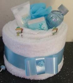 """I have been """"baking"""" towel cakes today. the christmas one looks lopsided but it is straight in real life and the pamper cake both were . Distintivos Baby Shower, Baby Shower Gift Basket, Shower Bebe, Baby Shower Gifts, Baby Gifts, Spa Cake, Pamper Cake, Diy For Girls, Gifts For Girls"""