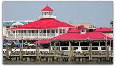 Fisherman's Wharf restaurant & where chartered boat rides & fishing excursions depart from in canal in Lewes, DE