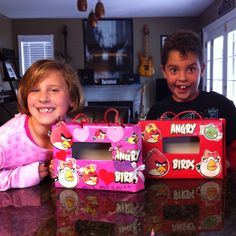 Valentine's Day card holders made out of cereal boxes Angry Birds style