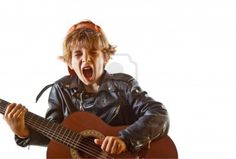 Image detail for -Stock Photo - Cute small kid playing guitar with great concentration ...