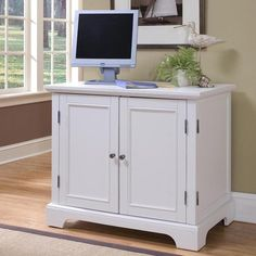 computer desk that closes up to hide most of the computer items.  Has room for a computer tower.  Nebraska Furniture Mart – Home Styles Compact Desk
