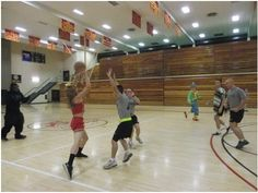 Cadets playing basketball in Halloween costumes.
