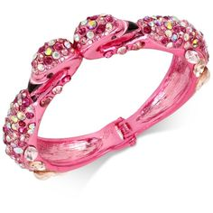Betsey Johnson goes Glam-ingo on this stunning stone and imitation pearl flamingo hinged bangle bracelet.