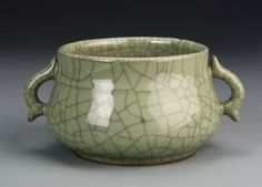 China, Ge ware censer, with a lovely crackle glaze in a light green hue, decorated with two small ears. Height 3 3/4 in.