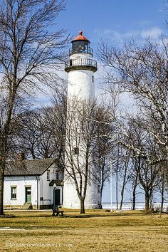 The first day of spring in Michigans Tip of the Thumb show the ice is still wrapping the shore at Pointe Aux Barques Lighthouse, Port Hope, Michigan. #lighthouse,#boating,#sailing,#winter,#michigan