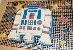 R2-D2 cake for C's 5th b-day: Star Wars! I used 2 large sheet pans - 1 chocolate cake & 1 yellow cake to keep all the kids happy. From an online photo, I free-handed the R2 shape onto brown paper & used as a stencil to cut the cakes to shape - yellow cake body & chocolate legs & feet. Added a crumb layer of white icing, then piped all outlines of shapes with round tip & filled in rest by piping with star tip. Betty Crocker fluffy white -add black food color for gray & Cake Mate red & blue…