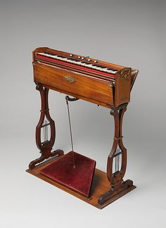 "1860 French Reed organ (physharmonica) at the Metropolitan Museum of Art, New York - From the curators' comments: ""The physharmonica is a small version of the melodicon and harmonium. Designed in Vienna in 1821 by Anton Haeckl, the physharmonica stood in many parlors by the end of the nineteenth century."""