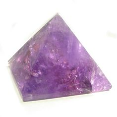 Amethyst Carved Pyramid - Amethyst has long been used to open the spiritual and psychic centers, making it an important power stone. It is also makes an excellent meditation aid.