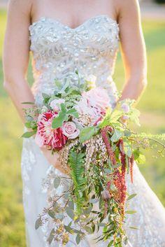 cascading bridal bouquet, photo by Lisa Mallory Photography http://ruffledblog.com/glam-new-years-inspiration #flowers #weddingbouquet
