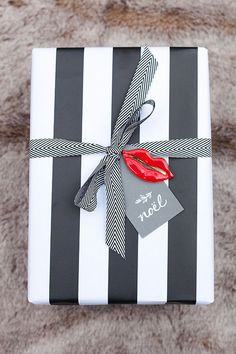 Pretty gift wrap, although I'd use a red or gold ribbon.