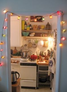 I have that same awkward space above my stove - add two shelves/hanging pot rack