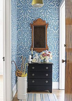 I absolutely adore the blue and white wall paper here.  And the mirror, and the rug, and.......