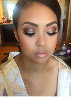 beautiful bridal makeup complete with wispy lashes, pink cheeks and pink lips