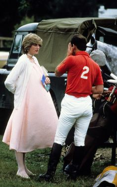 A very pregnant Princess Diana chatted with Prince Charles during a polo event in Windsor in June 1982..Oh Yea! God's Love