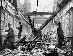 London readers continue to browse at a bombed-out library, WWII.