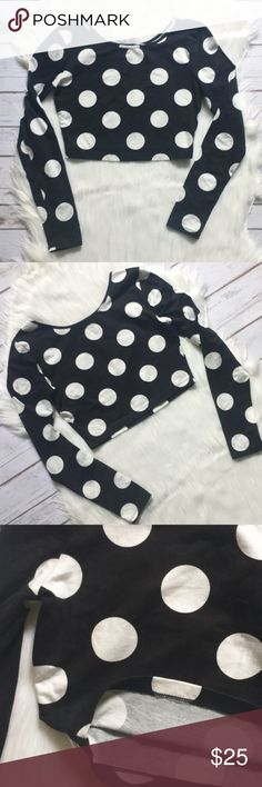 "Polka Dot Crop Top Forever 21. Long sleeve crop top. Round neck. Black with big white polka dots. Has stretch. 96% Cotton / 4% Spandex. Front and back are the same. Measurements on one side when laid flat: Length about 13.25"" from top of shoulder to hem. Underarm to underarm about 14.5"". Hem about 12"". In excellent condition. Forever 21 Tops Crop Tops"