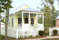 44 of the Most Impressive Tiny Houses You've Ever Seen. Cheerful Yellow Cottage Designed by Katrina Cottages, this charming little one-bedroom house measures wide and long, including a miniature front porch. Cute Small Houses, Little Houses, Tiny Houses, Beach House Plans, Small House Plans, Small Cottages, Beach Cottages, Up House, Tiny House Living