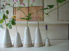 little white ceramic vases.