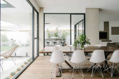 Example of a large trendy great room design in Adelaide with white walls and dark hardwood floors Black Window Trims, Black Windows, Modern Windows, Windows And Doors, Home Office, Townhouse Interior, London Townhouse, Natural Wood Flooring, Room Pictures