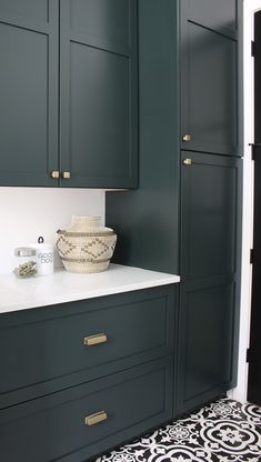 The Laundry/Dog Room: Dark Green Cabinets Layered On Classic Black + White Design - The House of Silver Lining - - A modern classic black and white laundry room layered with gorgeous dark green cabinets and natural white oak wood accents. Dark Green Kitchen, Green Kitchen Cabinets, Black Cabinets, Wood Cabinets, Kitchen Cabinet Paint Colors, Kitchen Taps, Kitchen Cabinetry, Cupboards, Diy Kitchen