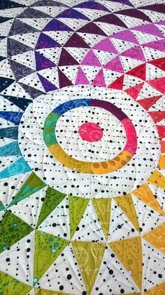 """Eclipse."" It was designed and pieced by Kimberly Bourne of Main Street Market Designs. Quilted by Barbie Mills 